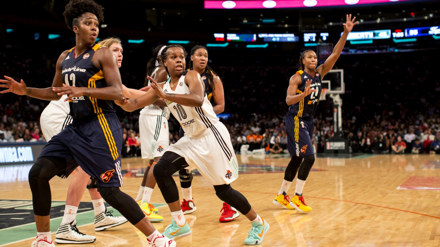 Epiphanny Prince guards Shenise Johnson #42 of the Indiana Fever during Game 3 of the Eastern Conference Finals.