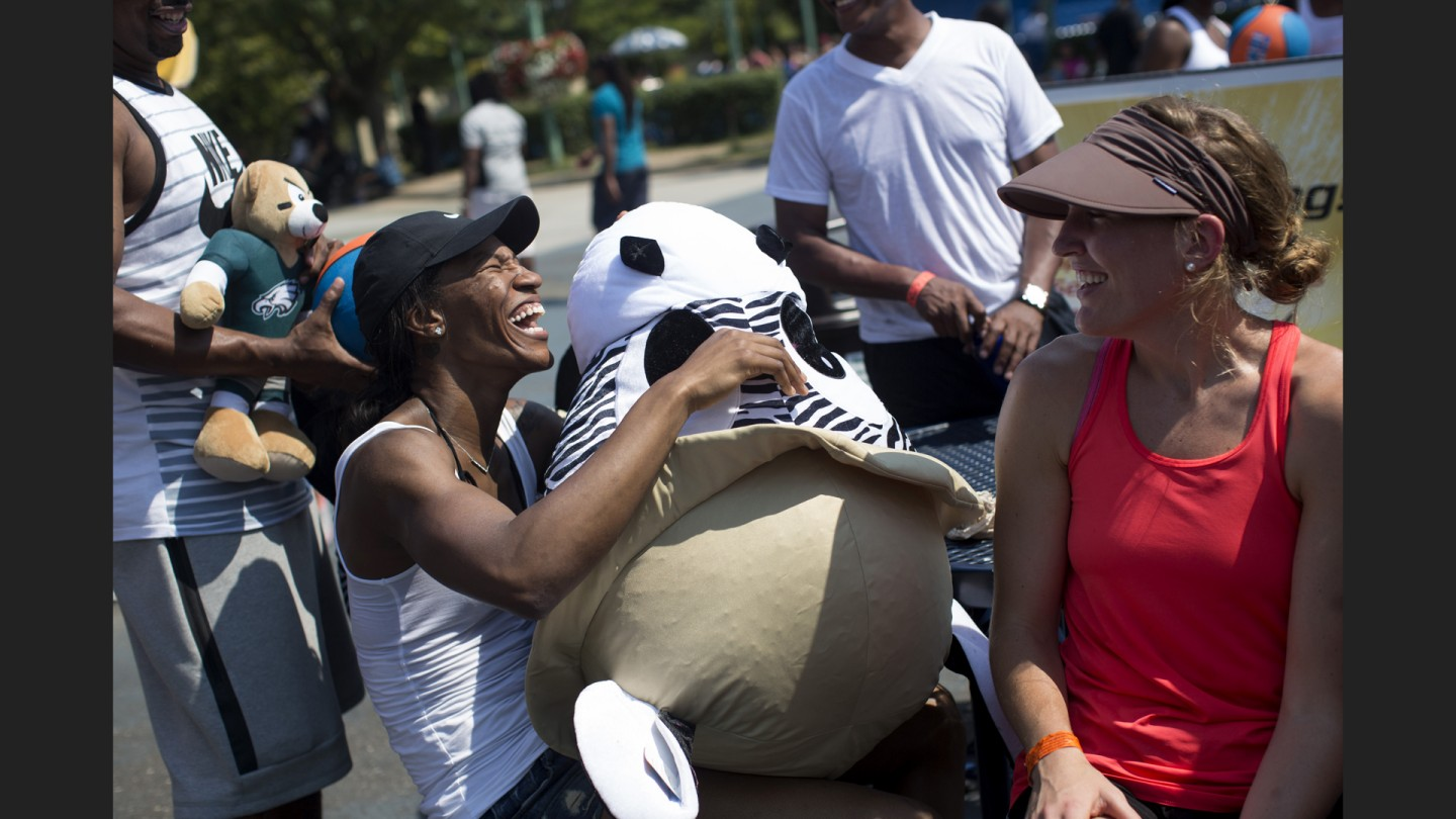 Avery Warley-Talbert laughs after her husband won her a stuffed animal.