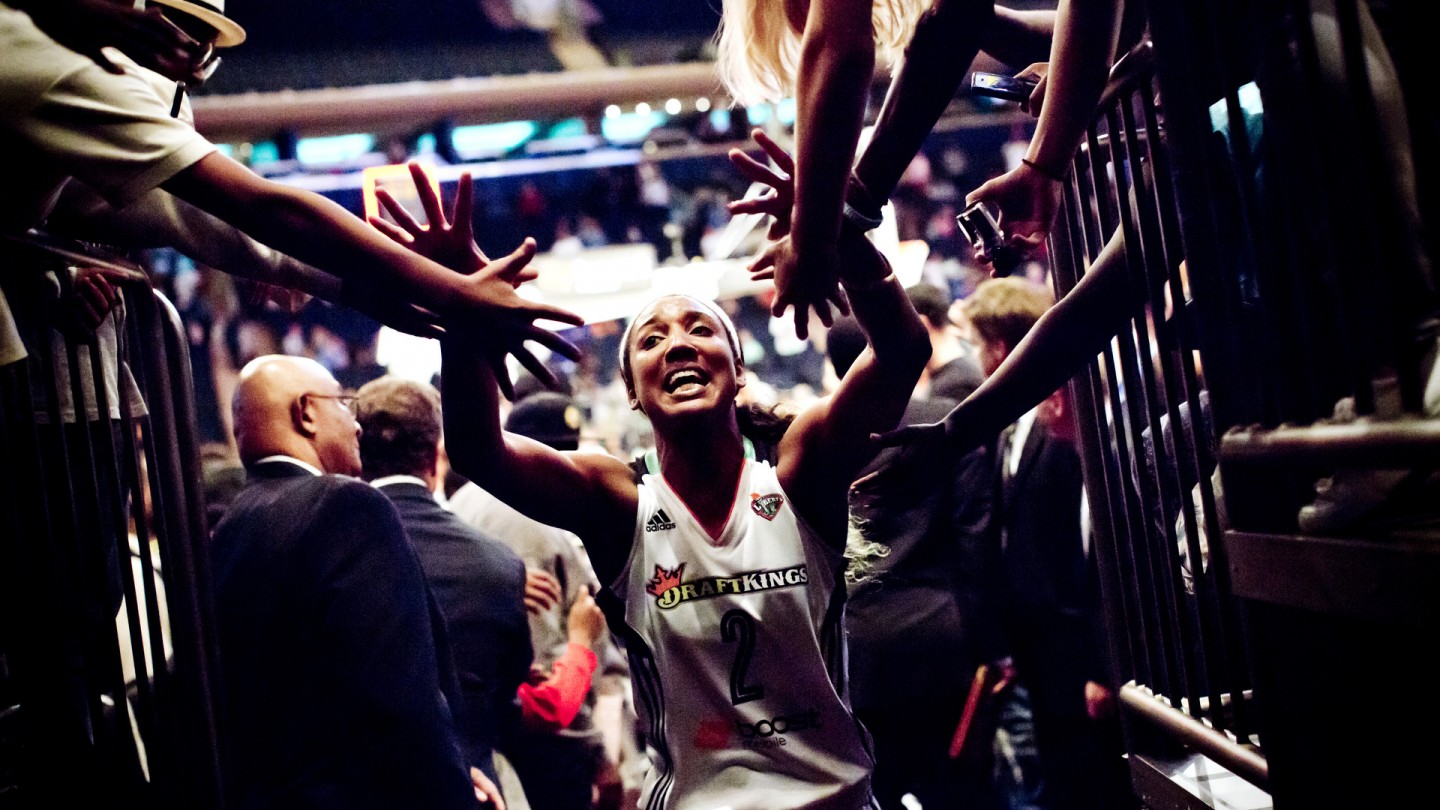 Candice Wiggins walks off the court after their loss against the Indiana Fever in the Eastern Conference Finals.