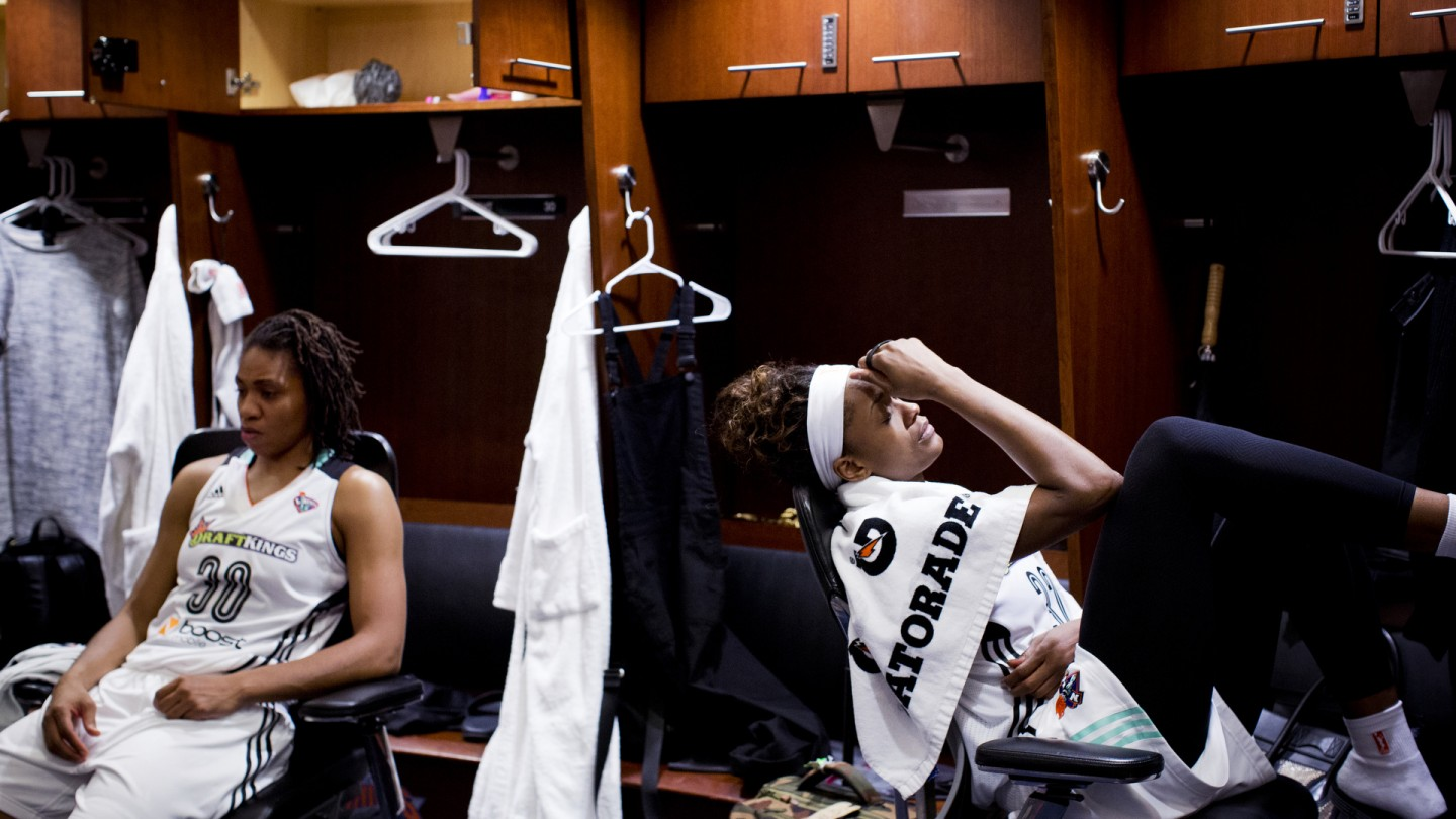 Tanisha Wright and Swin Cash sit in the locker room after their Eastern Conference Final loss.