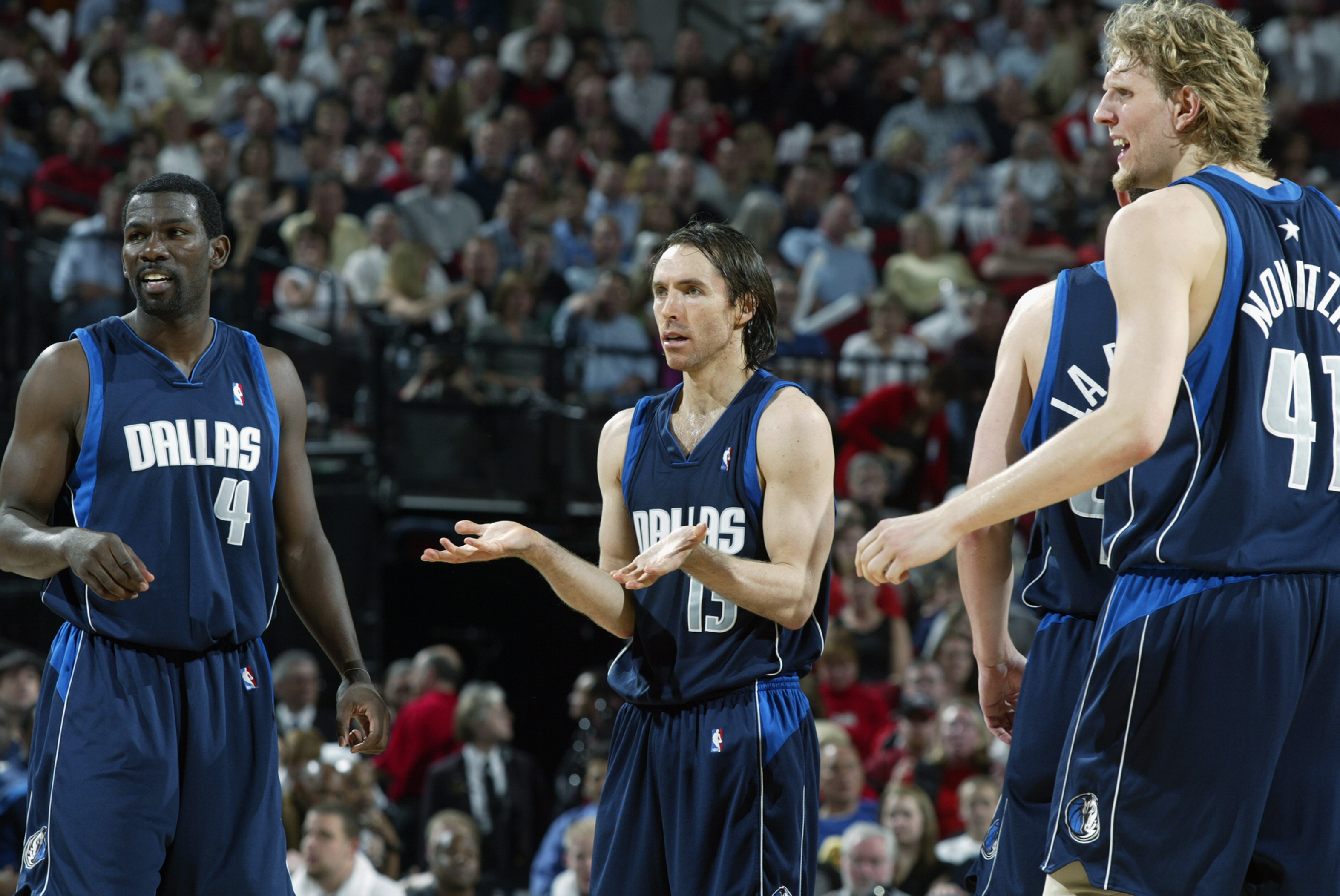Finley, Nash and Nowitzki react to a call