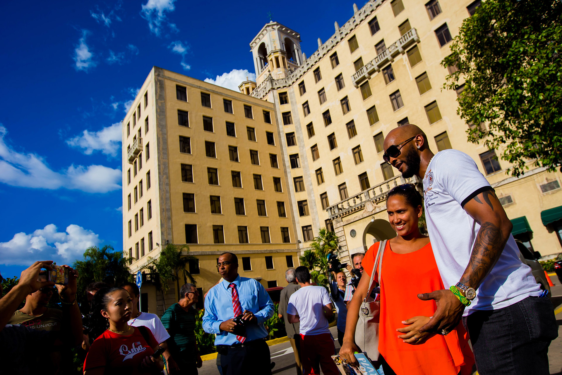 Free agent shortstop Alexei Ramirez meets with fans outside The Hotel Nacional.