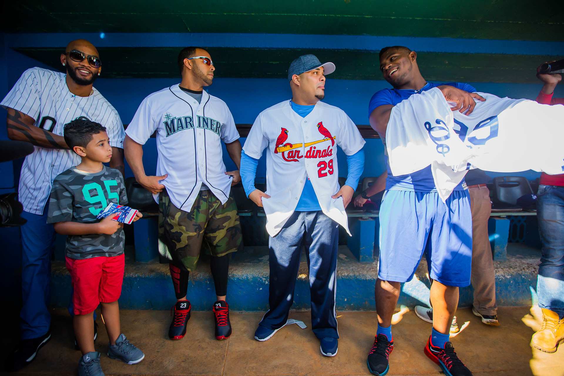 Alexei Ramirez, Nelson Cruz, Brayan Pena and Yasiel Puig before taking the field for the players' clinic.