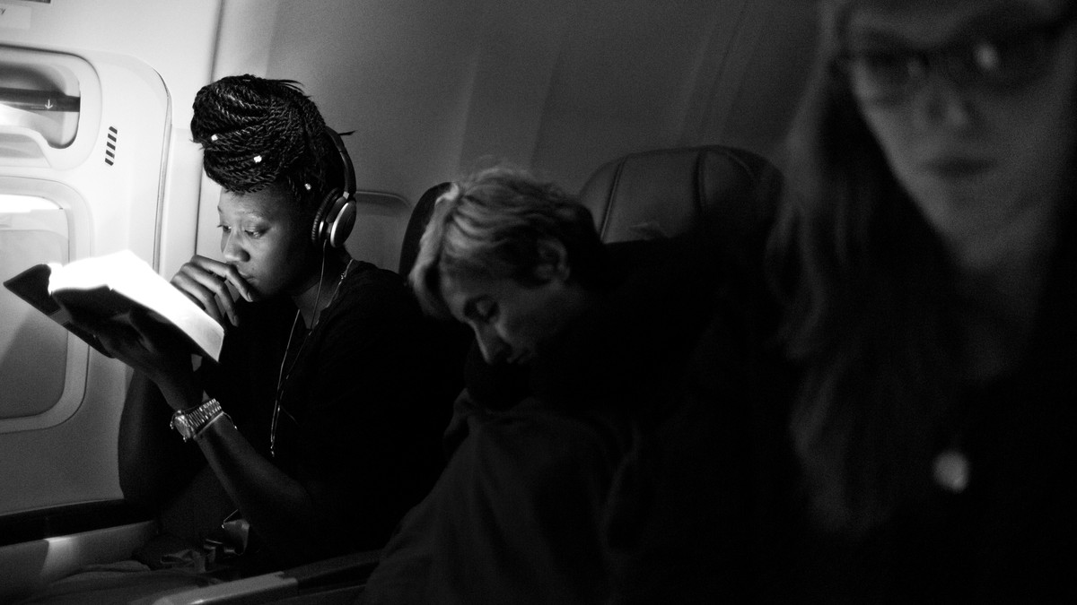Tina Charles reads on the plane traveling to San Antonio, Texas.