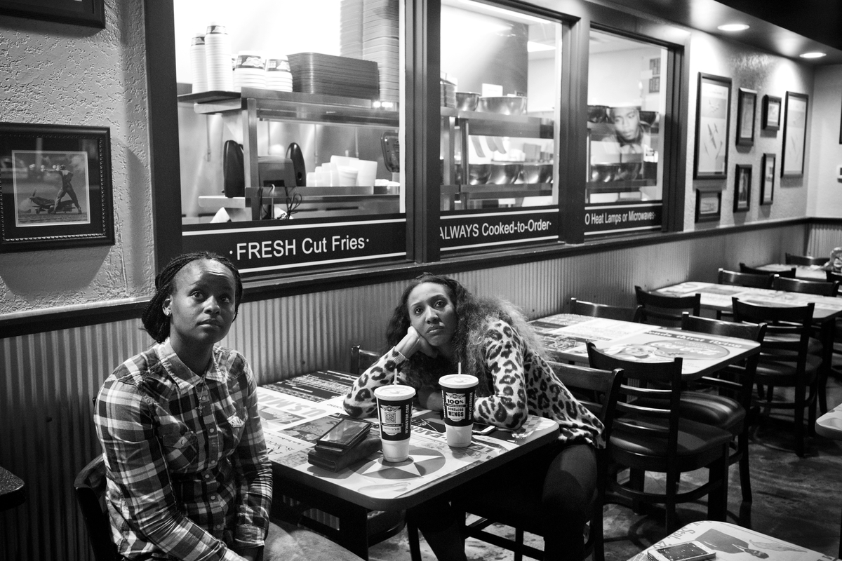 Candice Wiggins and Sugar Rodgers wait for their dinner at Wing Stop.