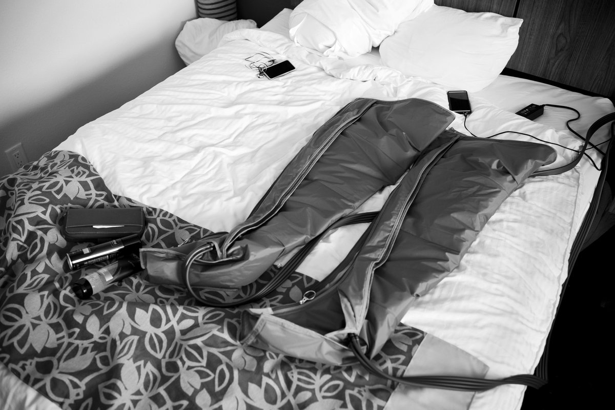 A deflated recovery pump rests on the bed.