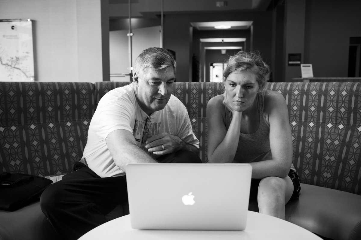New York Liberty head coach Bill Laimbeer reviews game footage with center Carolyn Swords in the hotel lobby.