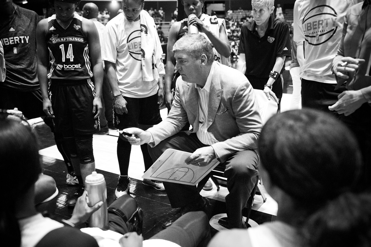 Head coach Bill Laimbeer talks to the team during the game against the San Antonio Stars.