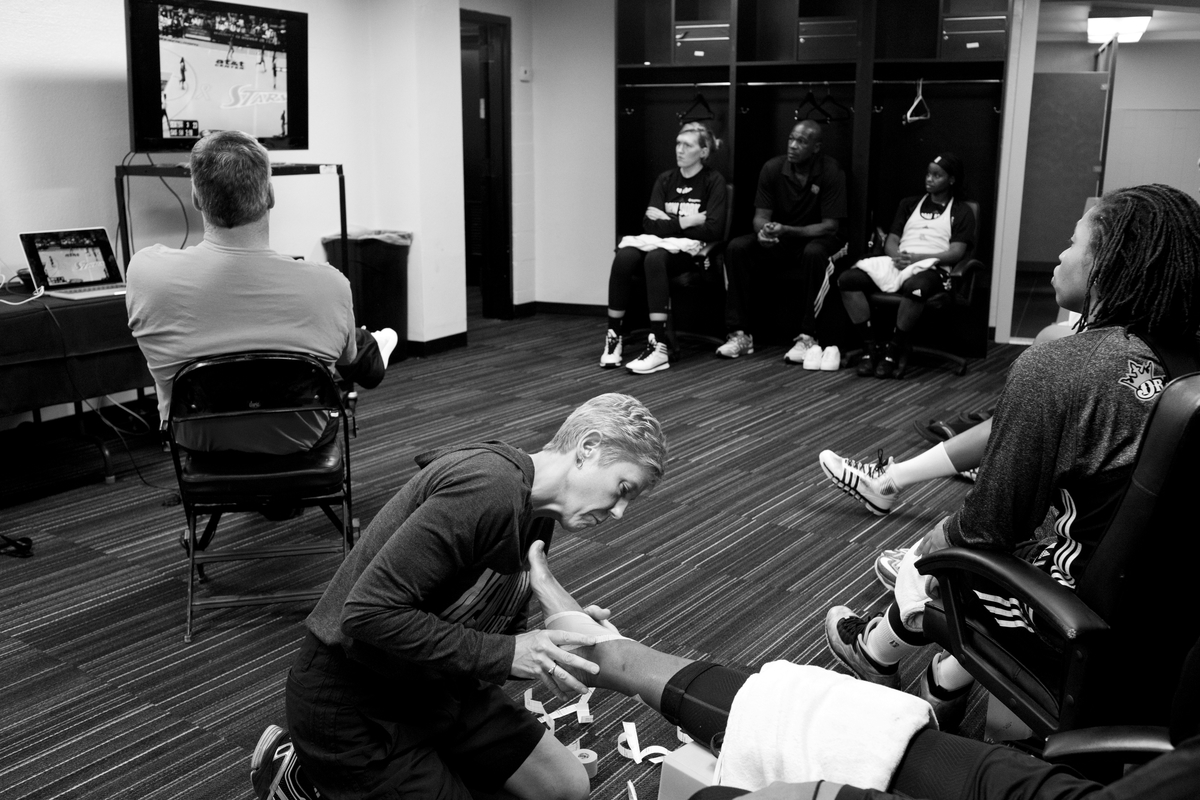 The team watches game footage in the locker room before their game against the San Antonio Stars.