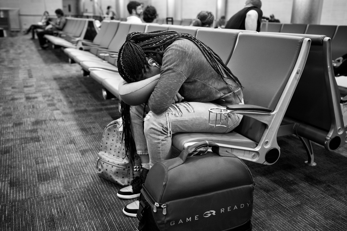 Brittany Boyd gets some rest in the airport as she waits to board the plane home.