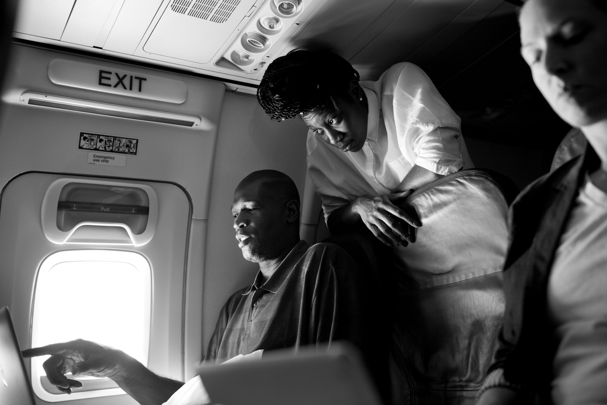 Tina Charles and Herb Williams review game footage on the plane.