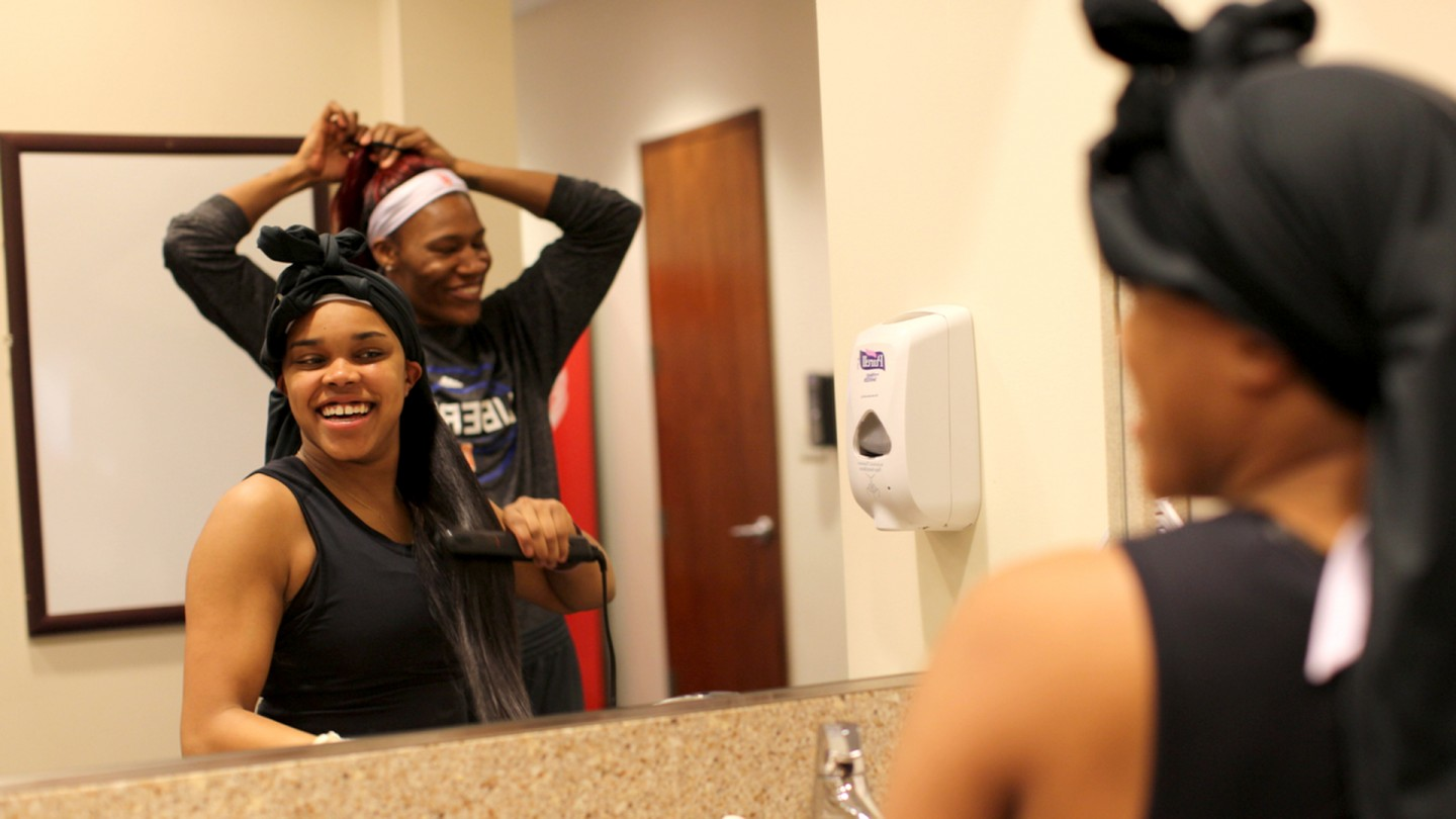 Brittany Boyd and Avery Warley-Talbert fix their hair before the game.