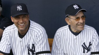 27 Feb 2007, Tampa, Florida, USA --- Derek Jeter and Yogi Berra sit in the dugout before the intra-squad game at New York Yankees Spring Training at Legends Field in Tampa. --- Image by © Munson, John/Star Ledger/Corbis