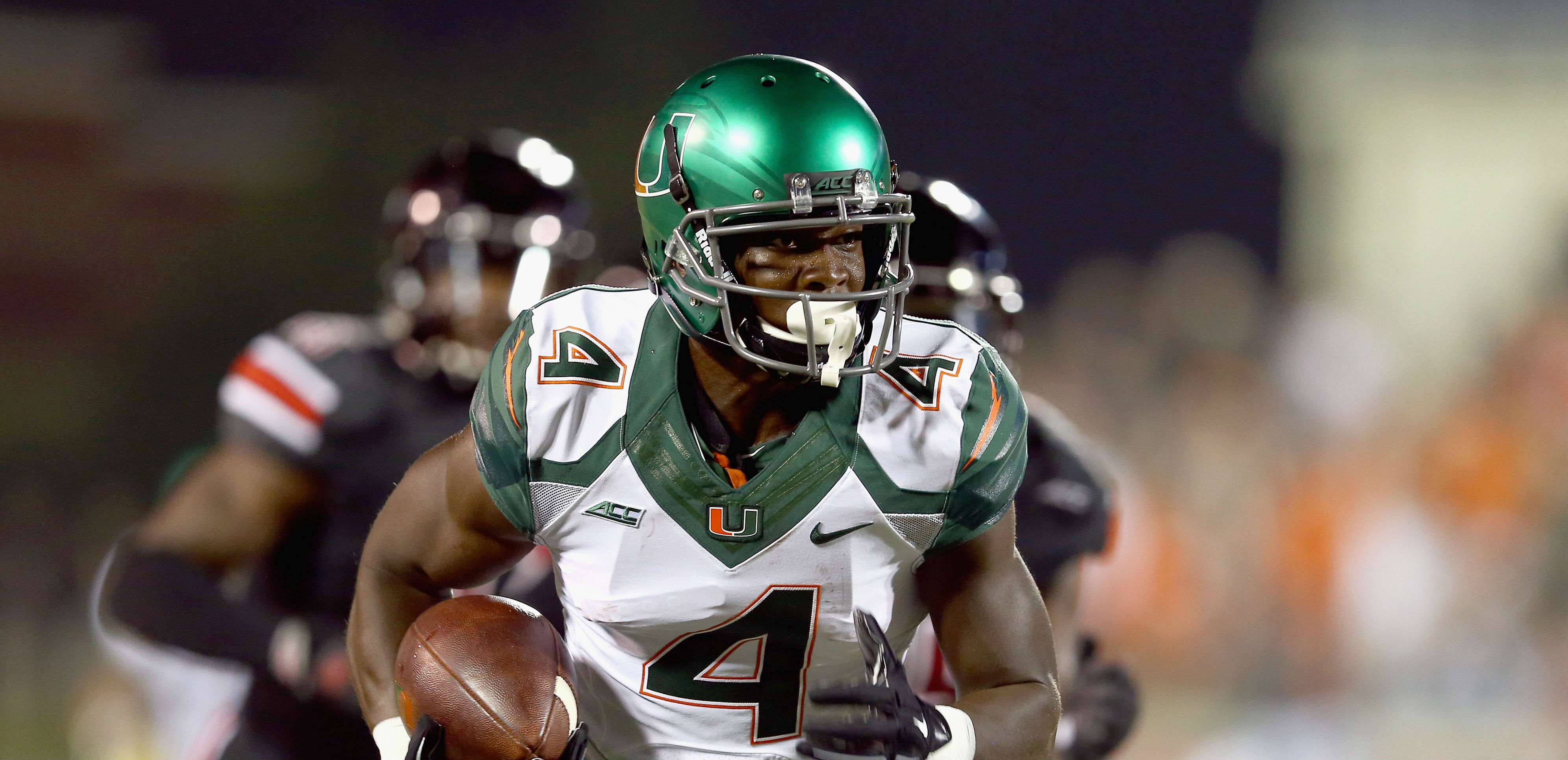 LOUISVILLE, KY - SEPTEMBER 01: Phillip Dorsett #4 of the Miami Huricanes runs with the ball during the game against the Louisville Cardinals at Papa John's Cardinal Stadium on September 1, 2014 in Louisville, Kentucky. (Photo by Andy Lyons/Getty Images)