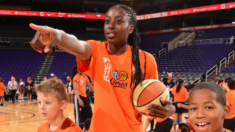 PHOENIX, AZ - JULY 18: Chiney Ogwumike #13 of the Connecticut Sun points during a WNBA All-Star Cares event on July 18, 2014 at US Airways Center in Phoenix, Arizona. NOTE TO USER: User expressly acknowledges and agrees that, by downloading and/or using this photograph, user is consenting to the terms and conditions of the Getty Images License Agreement. Mandatory Copyright Notice: Copyright 2014 NBAE (Photo by Barry Gossage/NBAE via Getty Images)