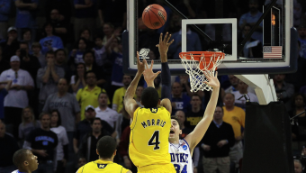 CHARLOTTE, NC - MARCH 20: Darius Morris #4 of the Michigan Wolverines misses a last-second tying shot over Ryan Kelly #34 of the Duke Blue Devils as the Wolverines lose 73-71 during the third round of the 2011 NCAA men's basketball tournament at Time Warner Cable Arena on March 20, 2011 in Charlotte, North Carolina. (Photo by Streeter Lecka/Getty Images)