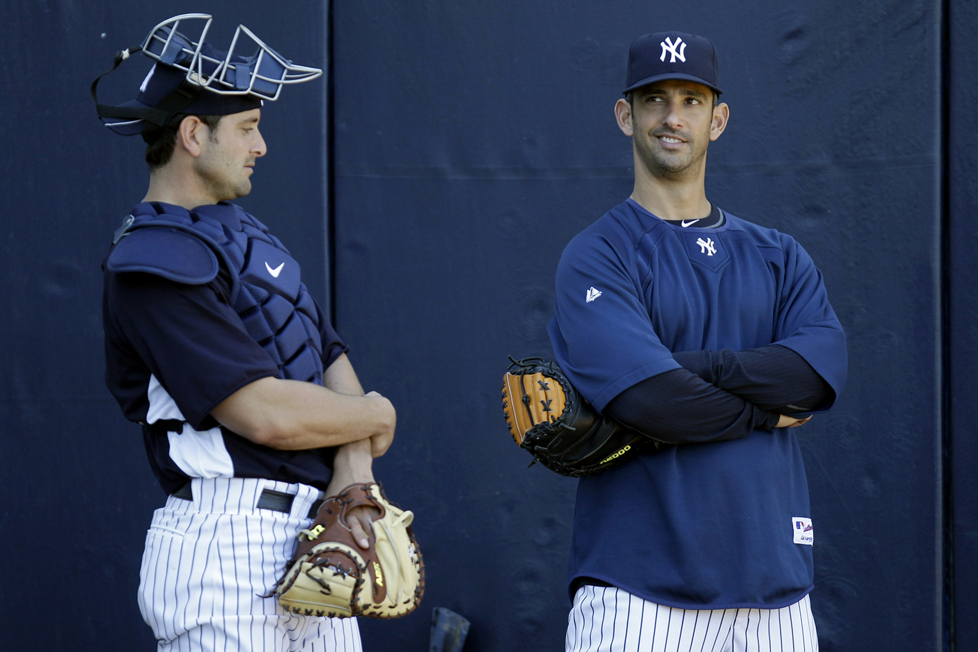 New York Yankees catchers Jorge Posada, right, and Francisco Cervelli, left, chat the first day of pitchers and catchers at spring training baseball Tuesday, Feb. 15, 2011, at Steinbrenner Field in Tampa, Fla. (AP Photo/Charlie Neibergall)