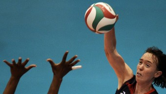 Cassidy Singer Lichtman of the United State spikes the ball during a women's volleyball semifinal match against Cuba at the Pan American Games in Guadalajara, Mexico, Wednesday, Oct. 19, 2011. Cuba won 3-1. (AP Photo/Daniel Ochoa de Olza)