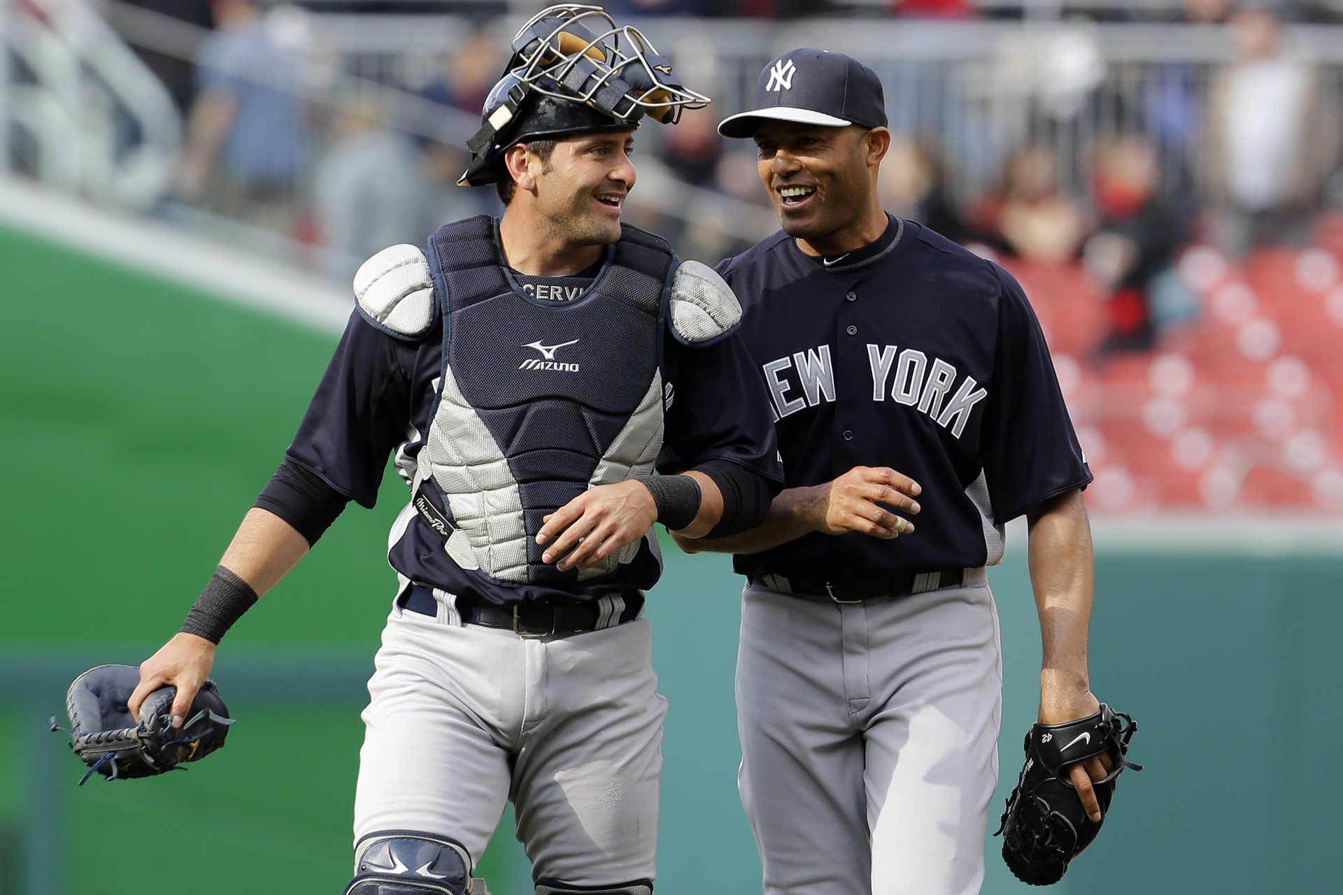 New York Yankees catcher Francisco Cervelli, left, smiles with relief pitcher Mariano Rivera after an exhibition baseball game against the Washington Nationals at Nationals Park, Friday, March 29, 2013, in Washington. The Yankees won 4-2. (AP Photo/Alex Brandon)