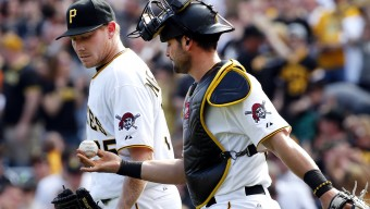 Pittsburgh Pirates relief pitcher Mark Melancon, left, takes the game ball from catcher Francisco Cervelli after getting the save during the Pirates home opener baseball game against the Detroit Tigers  in Pittsburgh Monday, April 13, 2015. The Pirates handed the Tigers their first loss of the season 5-4. (AP Photo/Gene J. Puskar)