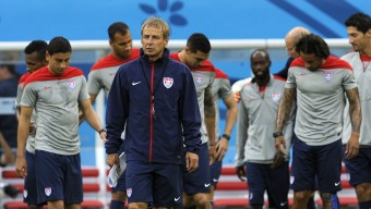 United States' Jurgen Klinsmann, center, walks on the pitch with his team during a training session at the Arena da Amazonia in Manaus, Brazil, Saturday, June 21, 2014. The U.S. will play Portugal in group G of the 2014 soccer World Cup on June 22. (AP Photo/Paulo Duarte)