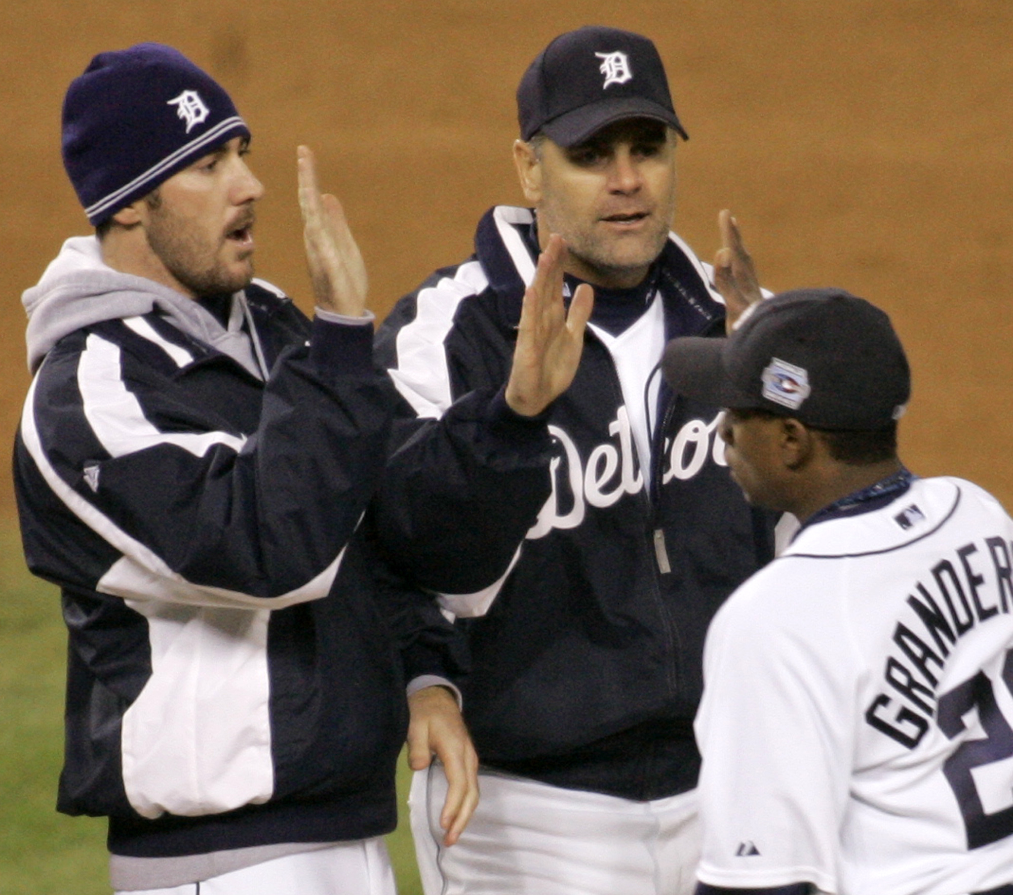 Detroit Tigers' Kenny Rogers, center, celebrates  with teammates Justin Verlander, left, and Curtis Granderson after the Tigers 3-1 victory over the St. Louis Cardinals in Game 2 of the World Series on Sunday, Oct. 22, 2006 in Detroit.  (AP Photo/Paul Sancya)
