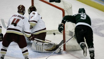 Michigan State's Justin Abdelkader, (9) watches as his shot sneaks past Boston College goalie Cory Schneider, center, and Mike Brennan for a goal during the third period in the NCAA Frozen Four championship hockey game Saturday, April 7, 2007 in St. Louis. Michigan State won the game, 3-1. (AP Photo/Jeff Roberson)