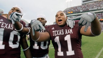 **FILE**Texas A&M's Jorvorskie Lane (11) celebrates with teammates Billy Chavis, left, and E.J. Shankle, center, after beating Fresno State in three overtimes of their NCAA football game Saturday, Sept. 8, 2007, in College Station, Texas. Lane, Texas A&M's 6-foot, 274-pound tailback, keeps telling coaches to find more ways to use him. When he's not running over defenders, he's throwing perfect 49-yard passes before carrying it the final yard for a score. He catches touchdown passes, too. And he says he can punt. (AP Photo/David J. Phillip, File)