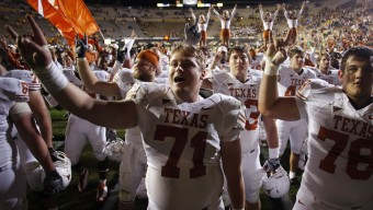 Texas centers Chris Hall, left, and David Snow celebrate after a 38-14 victory by Texas over Colorado in an NCAA college football game in Boulder, Colo., on Saturday, Oct. 4, 2008. (AP Photo/David Zalubowski)
