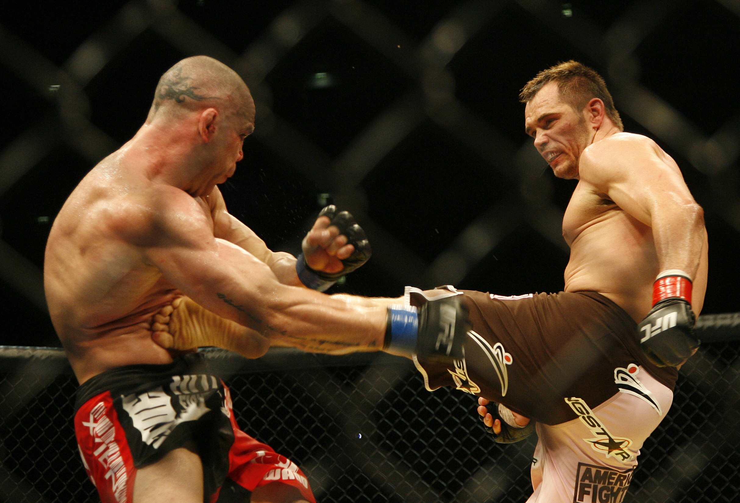 Silva Wanderlei from Brazil, left, fights against United States' Rich Franklin from Cincinnati, Ohio during their Ultimate Fighting Championship bout in Cologne, Germany, on Saturday, June 13, 2009. The Ultimate Fighting Championship, UFC, is the world's leading professional mixed martial arts, MMA, organization. Franklin won the bout. (AP Photo/Hermann J. Knippertz)
