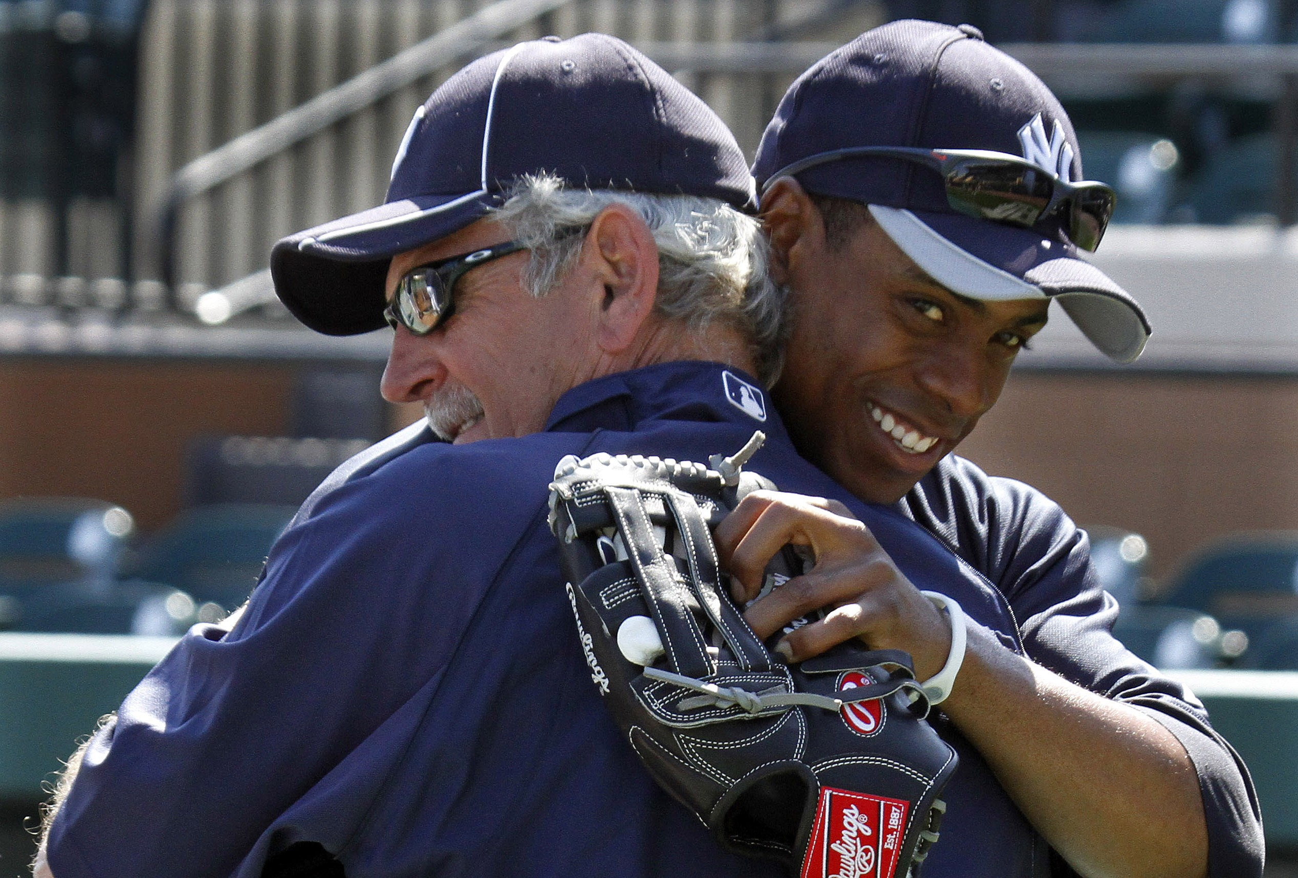 New York Yankees' Curtis Granderson, right, hugs Jim Leyland his old manager with the Detroit Tigers before a spring training baseball game between the Yankees and the Tigers in Lakeland, Fla., Wednesday, March 10, 2010.  (AP Photo/Gene J. Puskar)