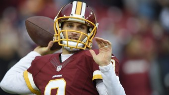 Washington Redskins quarterback Kirk Cousins (8) warms up before an NFL wild card playoff football game against the Green Bay Packers in Landover, Md., Sunday, Jan. 10, 2016. (AP Photo/Nick Wass)