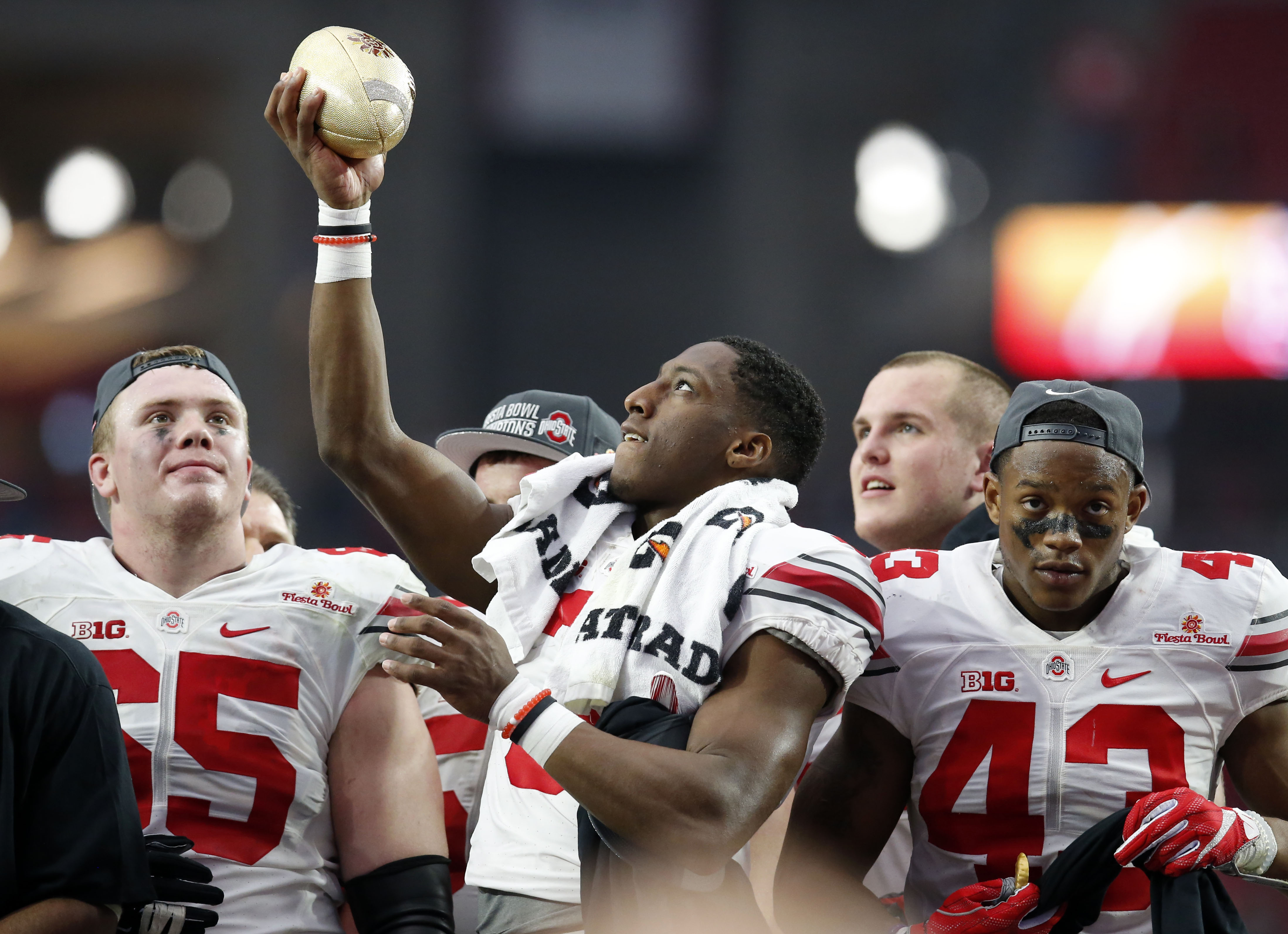Ohio State wide receiver Michael Thomas (3) raises the champions trophy after the Fiesta Bowl NCAA College football game against Notre Dame, Friday, Jan. 1, 2016, in Glendale, Ariz. Ohio State won 44-28. (AP Photo/Rick Scuteri)