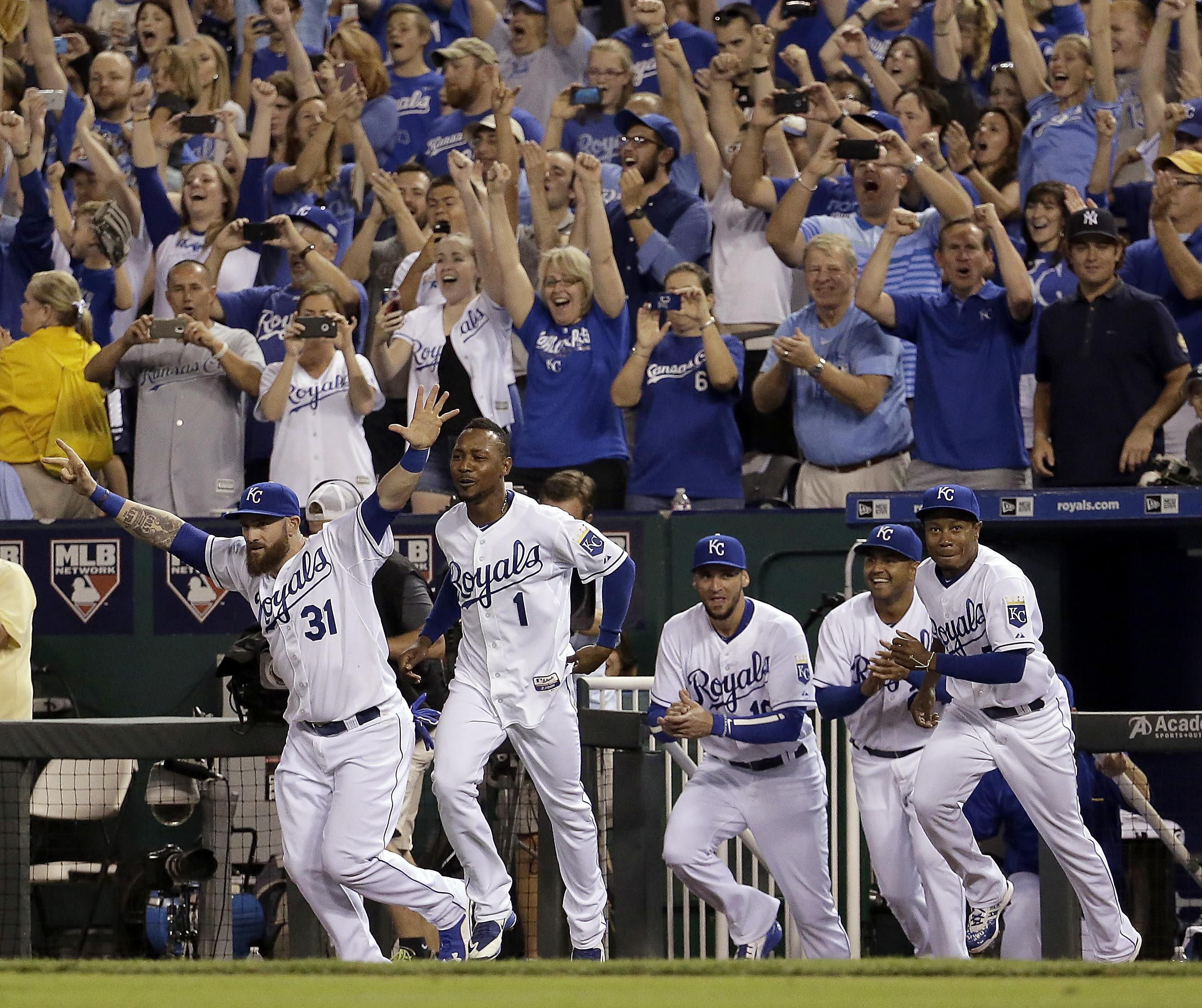 Kansas City Royals players celebrate after a baseball game against the Seattle Mariners on Thursday, Sept. 24, 2015, in Kansas City, Mo. The Royals won 10-4 to clinch the AL Central. (AP Photo/Charlie Riedel)