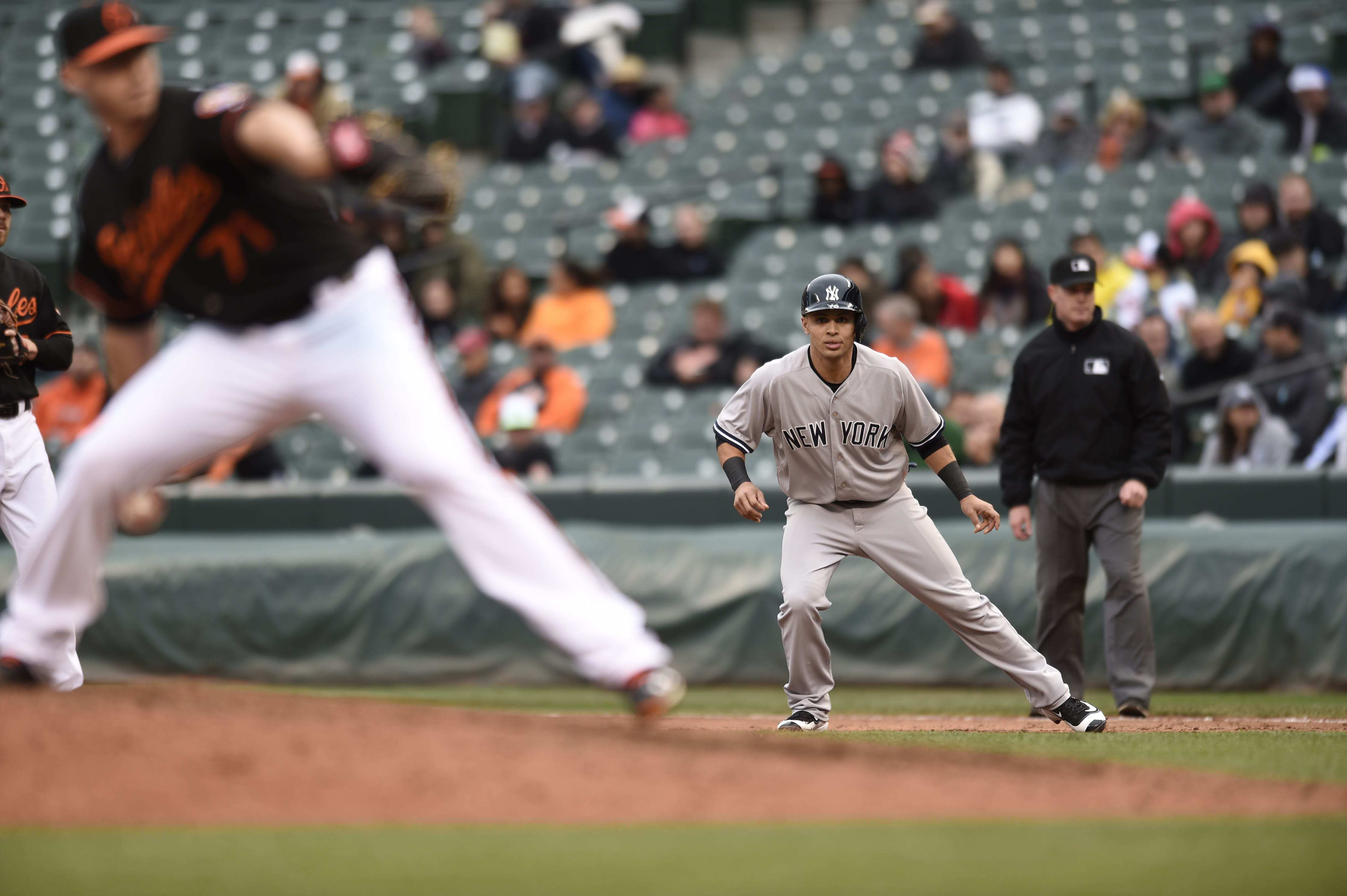 New York Yankees Rico Noel takes a lead off first base after hitting a single against the Baltimore Orioles in the  first baseball game of a double header in Baltimore, Saturday, Oct. 3, 2015. (AP Photo/Gail Burton)