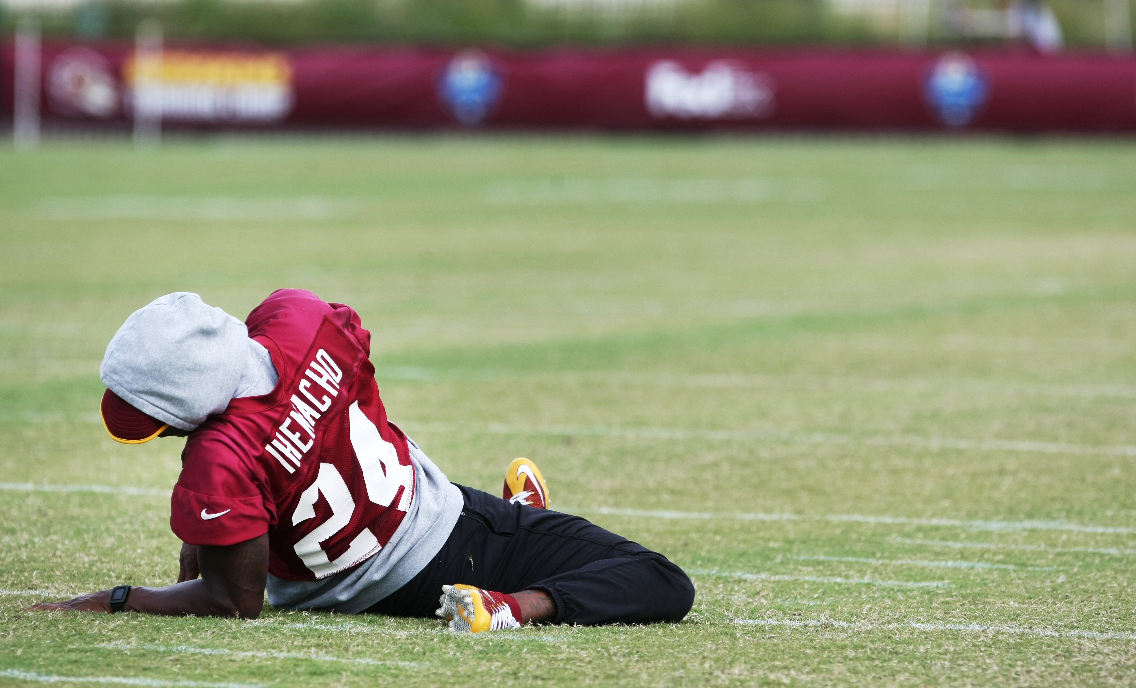 Washington Redskins defensive back Duke Ihenacho stretches during the team's NFL football training camp in Richmond, Va., Monday, Aug. 3, 2015.   (AP Photo/Jason Hirschfeld)