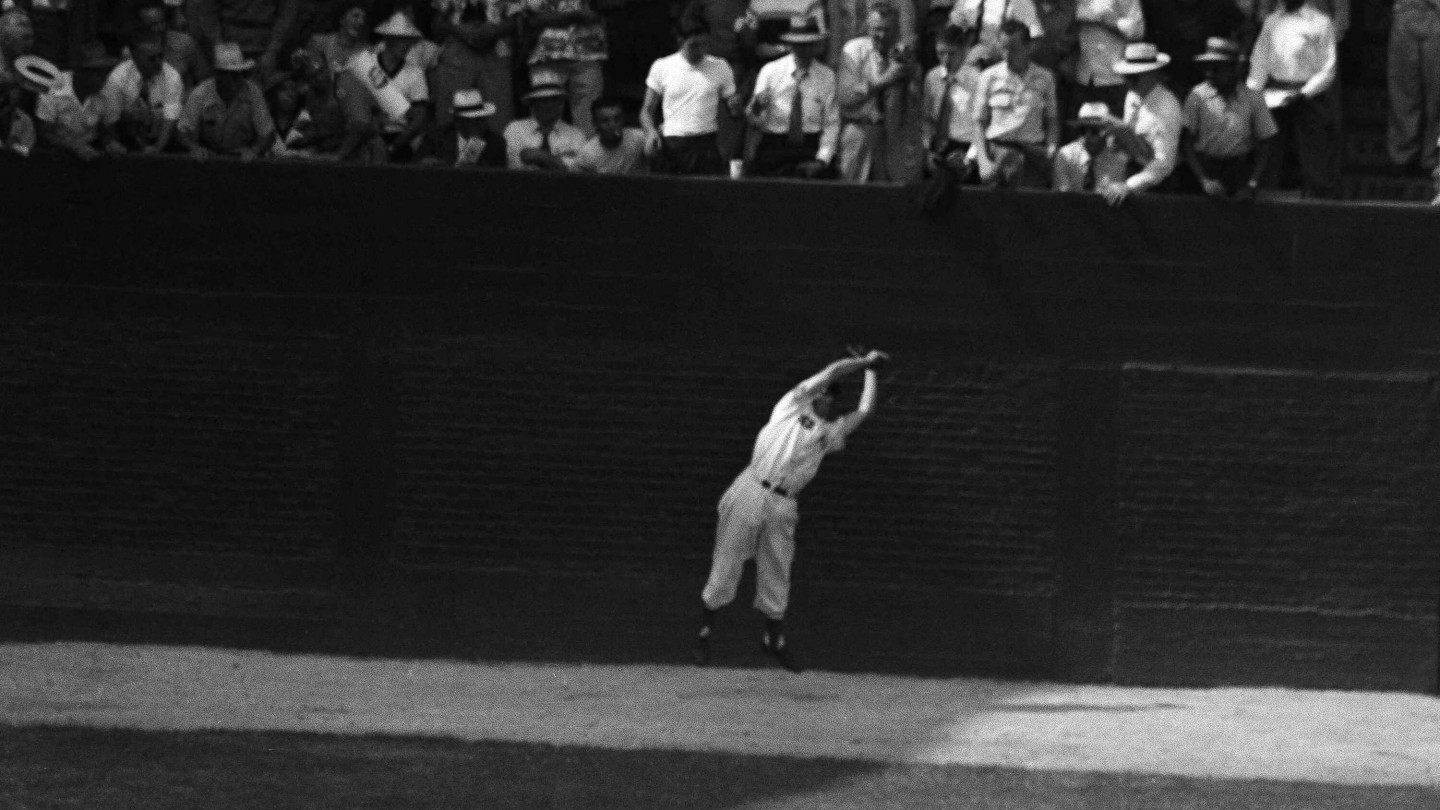 The 1950 All-Star Game was the first to go to extra innings. Here, Dom DiMaggio catches a long fly off the bat of the Cubs' Andy Pafko with the bases loaded for the third out in the 11th inning. The NL went on to win, 4-3, in the 14th inning.