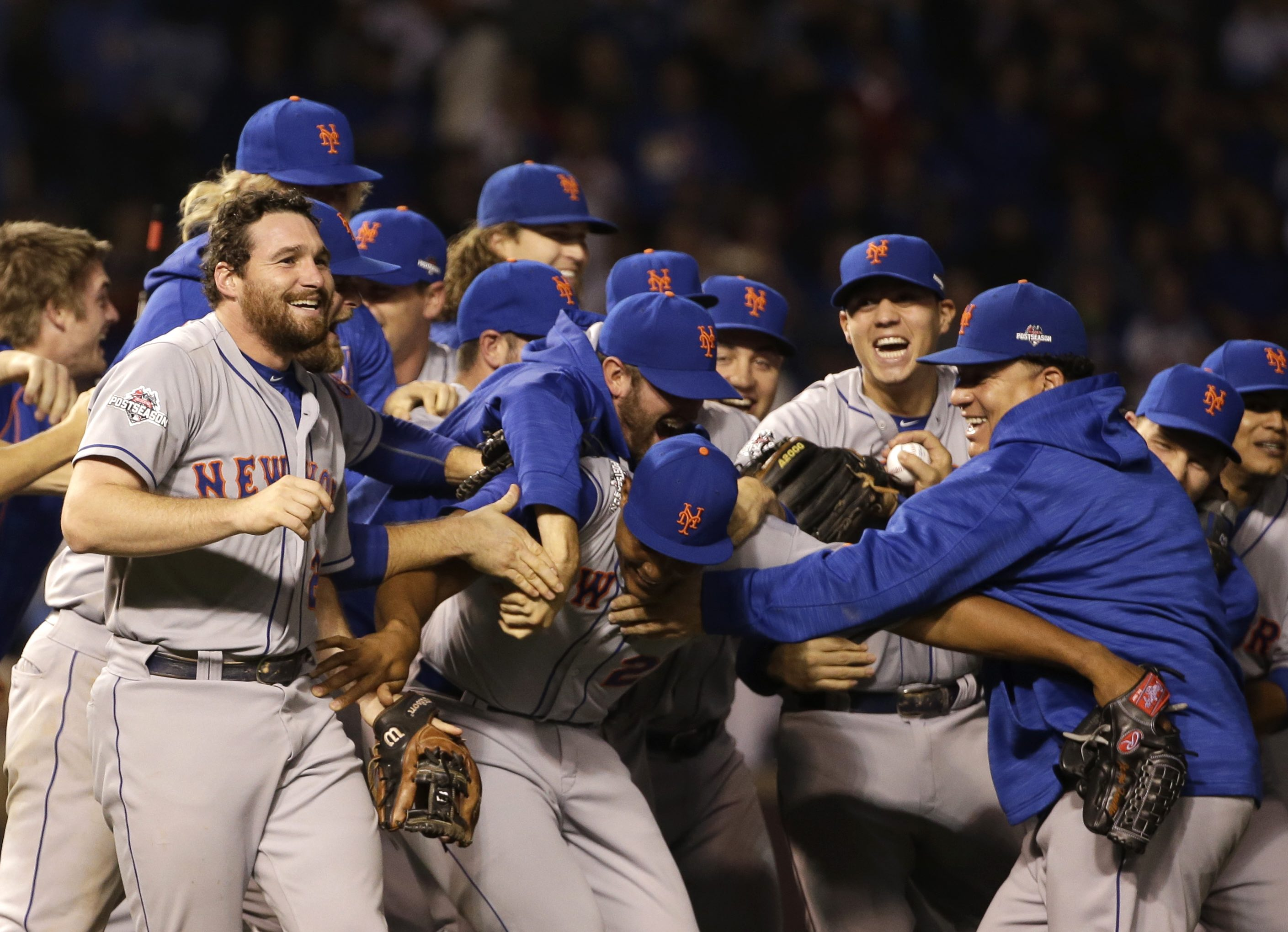 The New York Mets celebrate after Game 4 of the National League baseball championship series against the Chicago Cubs Wednesday, Oct. 21, 2015, in Chicago. The Mets won 8-3 to advance to the World Series. (AP Photo/David J. Phillip)