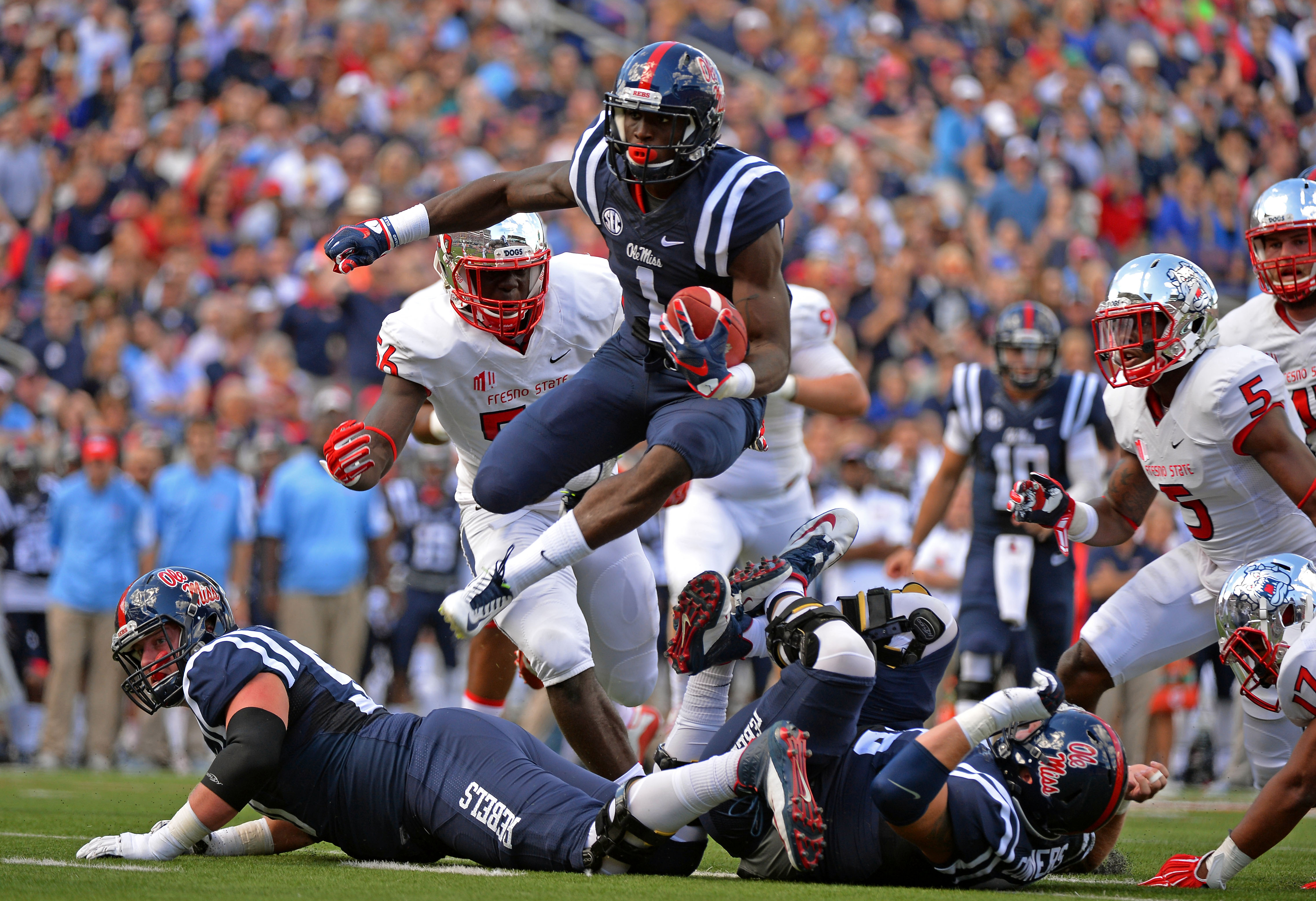 Mississippi wide receiver Laquon Treadwell (1) carries the ball after a catch in the first quarter of an NCAA college football game against Fresno State in Oxford, Miss., Saturday, Sept. 12, 2015. (AP Photo/Thomas Graning)