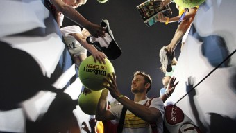 Mardy Fish signs autographs after his match against Go Soeda, of Japan, in the first round of play at the 2012 US Open tennis tournament, Monday, Aug. 27, 2012, in New York. (AP Photo/Kathy Willens)