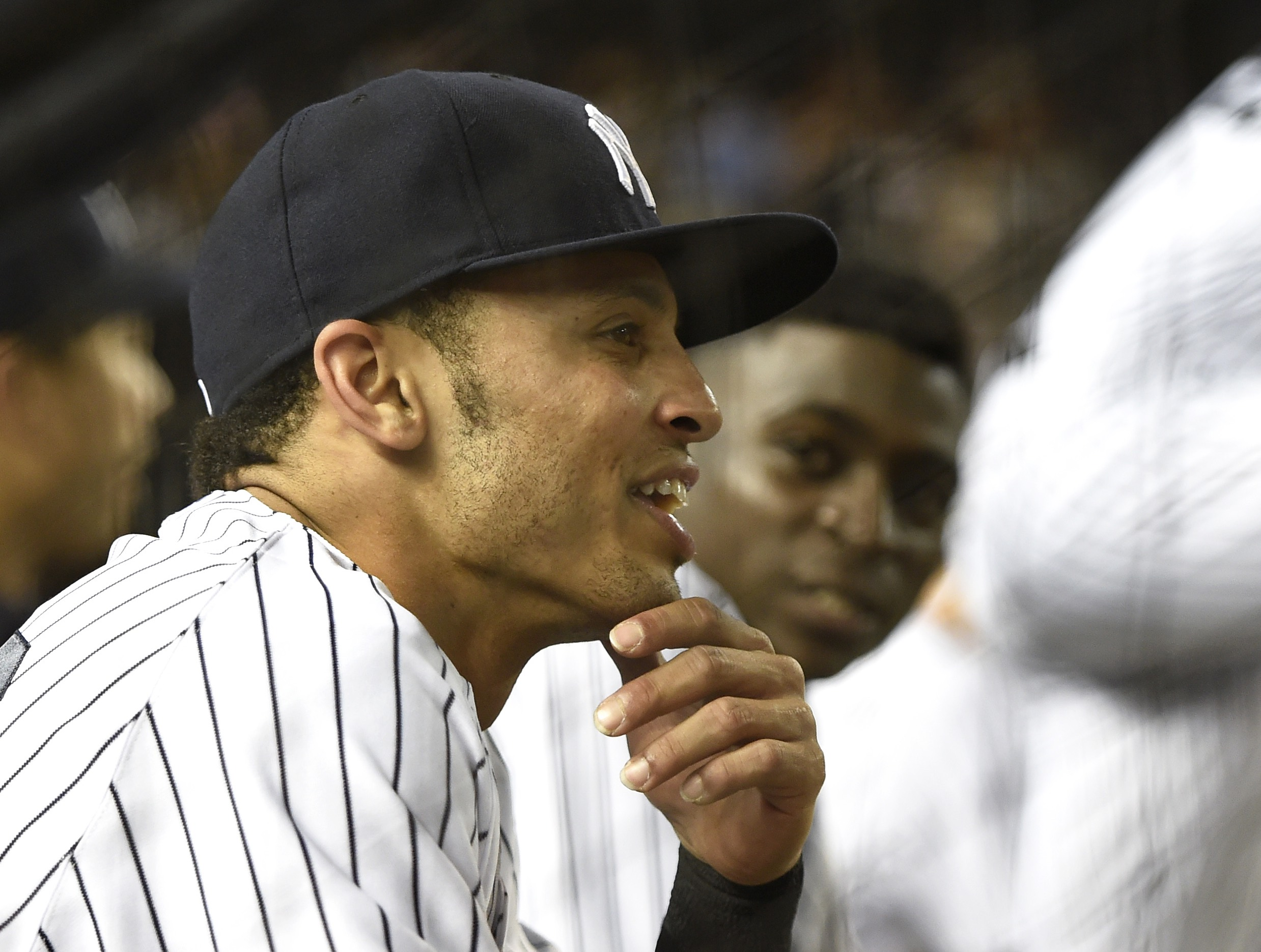 FILE- In this Sept. 4, 2015, file photo, New York Yankees' Rico Noel from the dugout during a baseball game against the Tampa Bay Rays at Yankee Stadium in New York. Will the 26-year-old speedster, whose September role is to pinch run, ever get a chance to hit, or will he join Moonlight Graham and become the 86th major league position player who never got to bat? (AP Photo/Kathy Kmonicek, File)