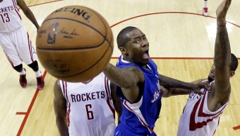 Los Angeles Clippers' Jamal Crawford, center, drives to the basket between Houston Rockets defenders Terrence Jones (6) and Trevor Ariza, right, during the second half of Game 2 in a second-round NBA basketball playoff series, Wednesday, May 6, 2015, in Houston. (AP Photo/David J. Phillip)