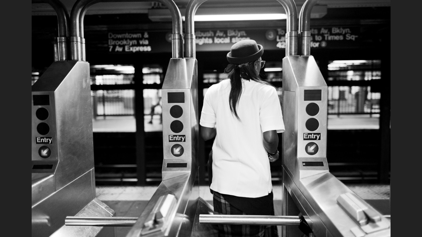 Essence Carson rides the subway from her Harlem apartment to the game at Madison Square Garden.