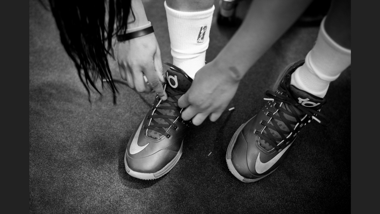 Brittany Boyd ties up her Kevin Durant shoes before the game.