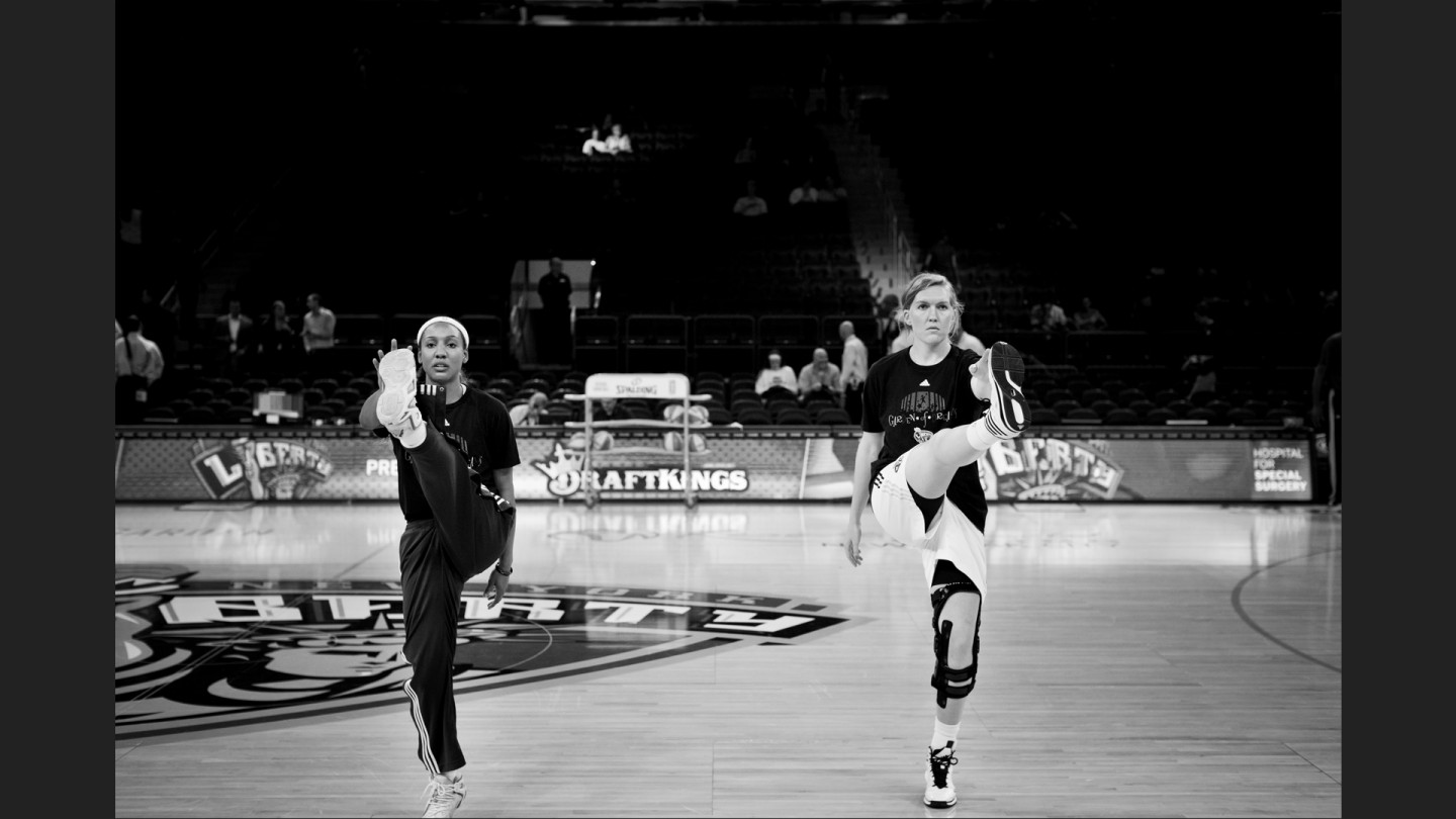 Candice Wiggins and Carolyn Swords do their routine pregame warmup.