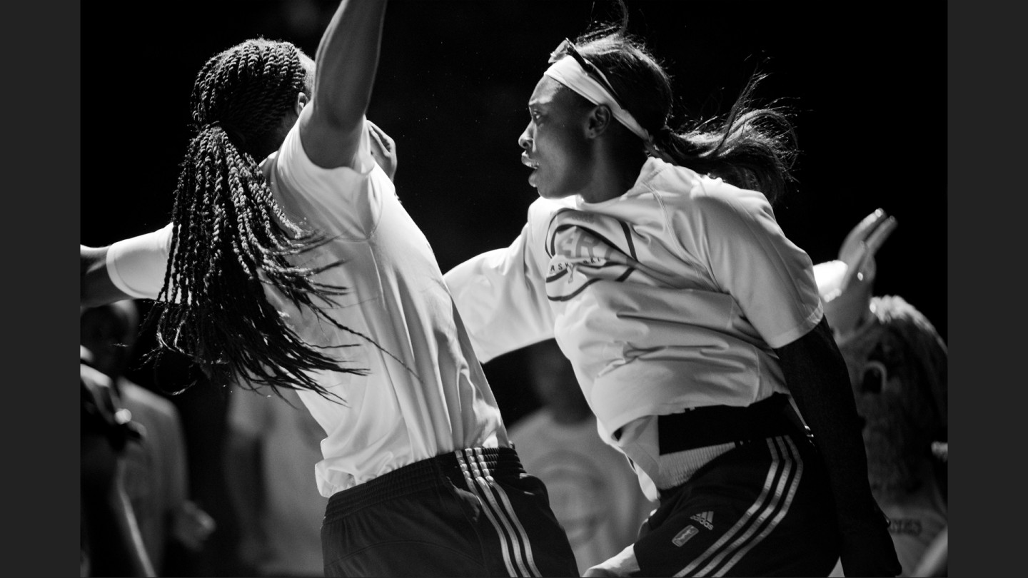 Essence Carson and Brittany Boyd chest bump during starting lineup announcements.