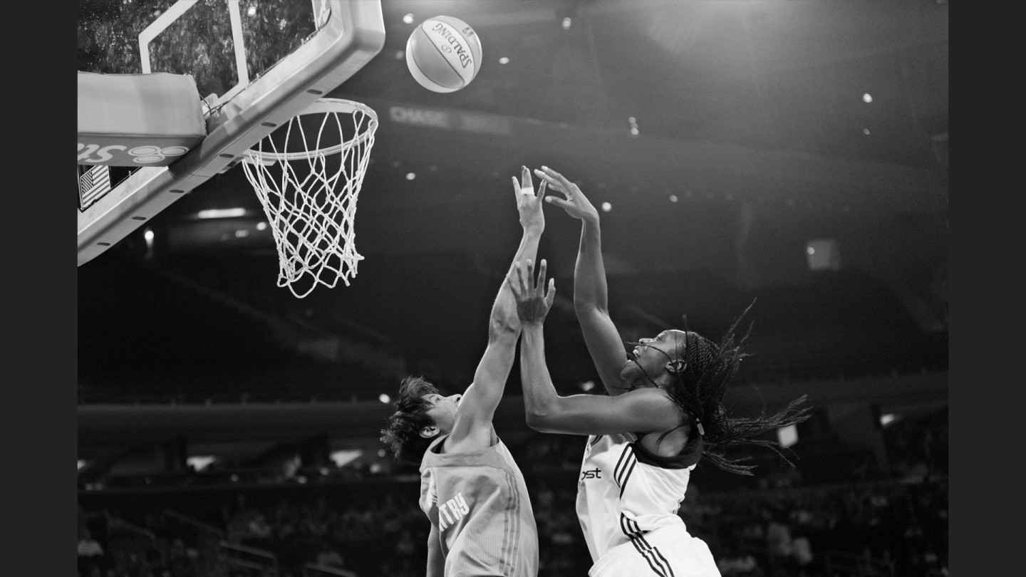 Tina Charles scores in the game against the Atlanta Dream.