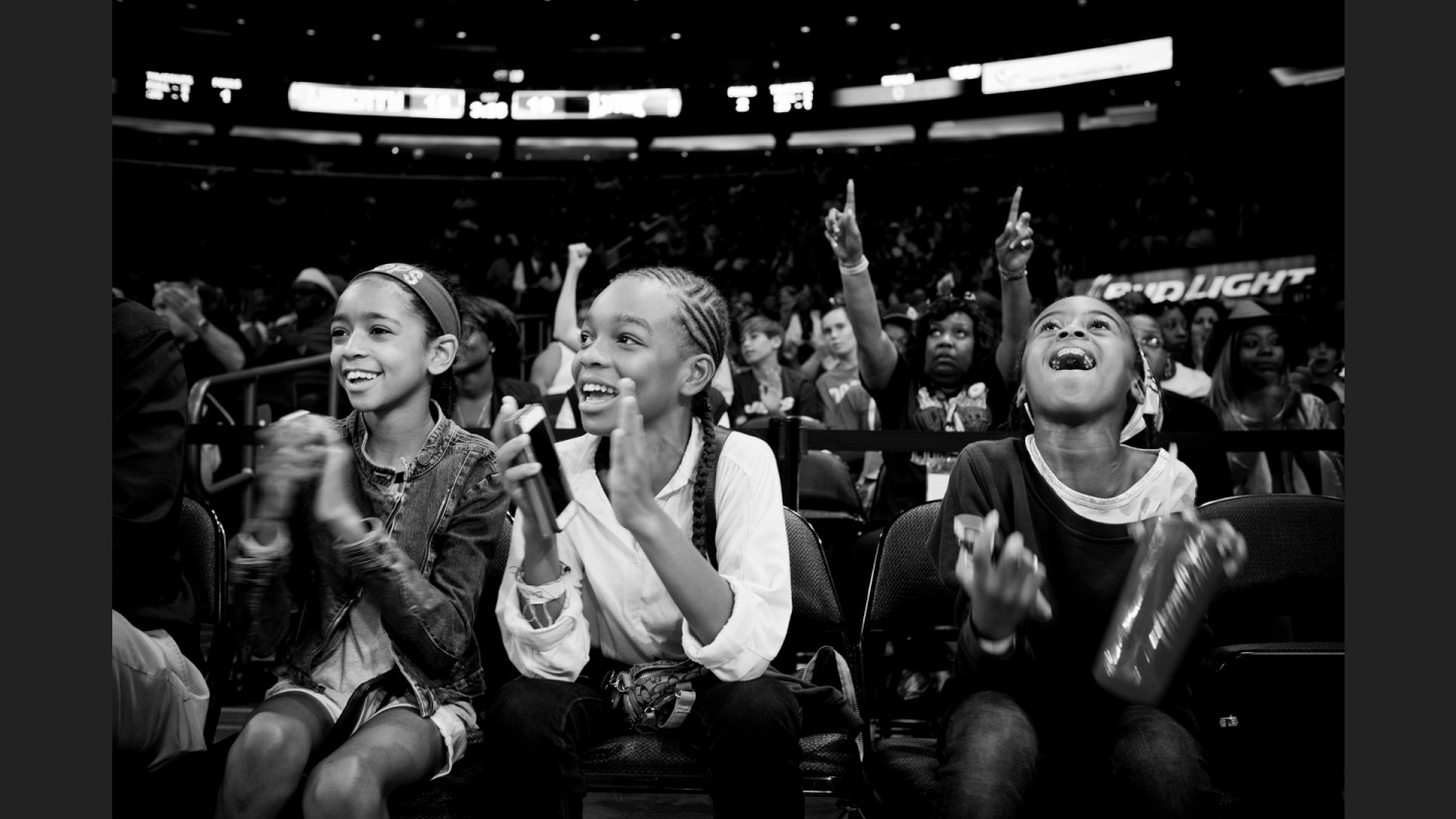 Young fans cheer on the Liberty.