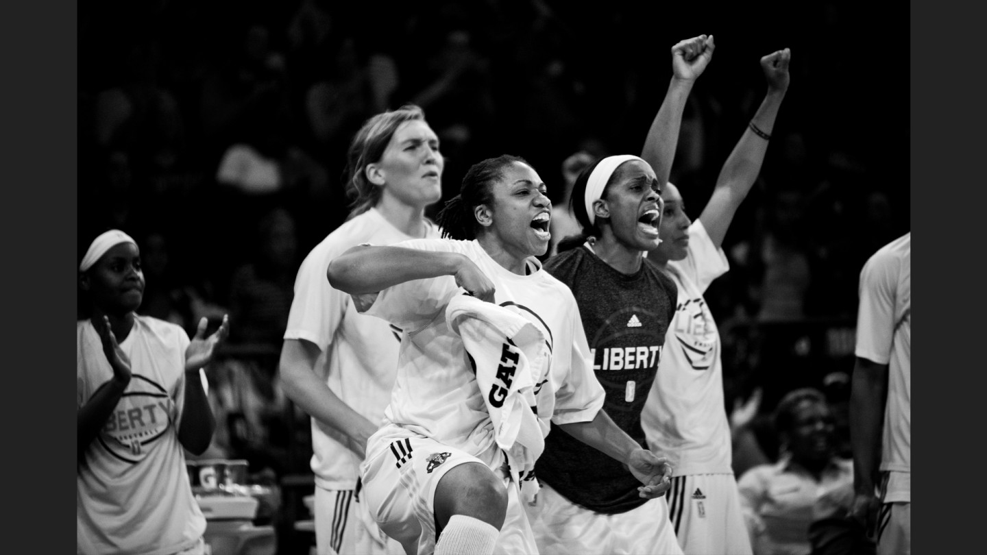 Sugar Rodgers, Carolyn Swords, Swin Cash, Tanisha Wright and Candice Wiggins cheer on their team during the game against the Atlanta Dream.