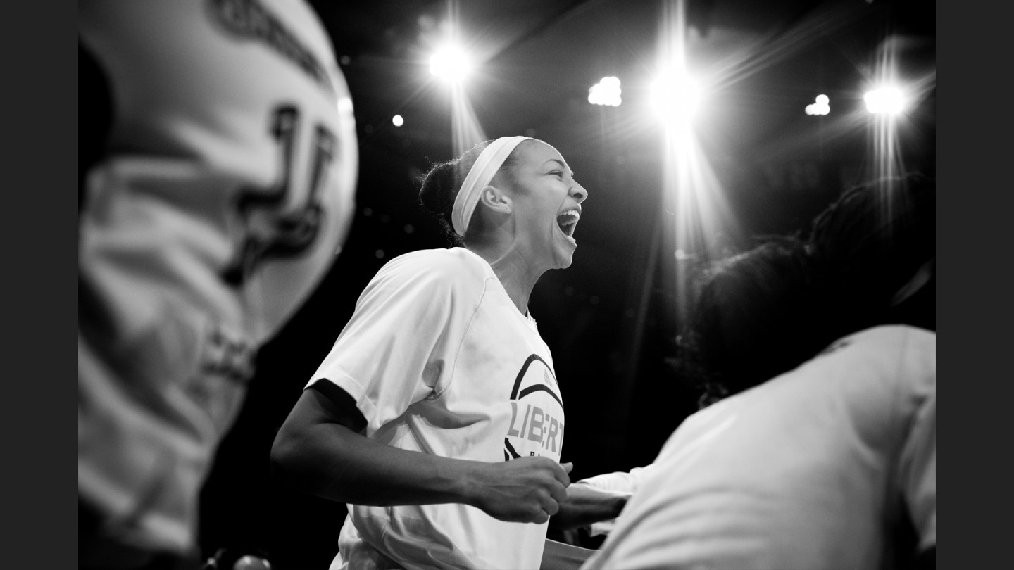 Kiah Stokes jumps up in excitement during the game against the Minnesota Lynx.